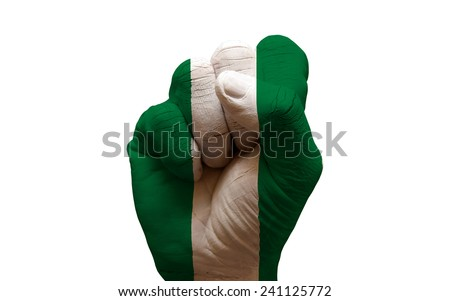 man hand fist painted country flag of nigeria - stock photo