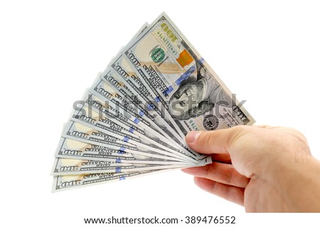 man hand giving 100 dollar bills isolated on white background - stock photo