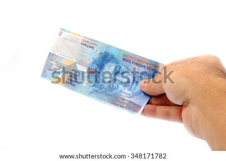 man hand giving 100 swiss franc banknote isolated isolated on white background
