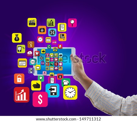 Man hand hold digital tablet with colorful application and social media icon on purple background - stock photo
