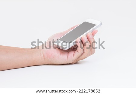 Man hand hold mobile phone on white background - stock photo