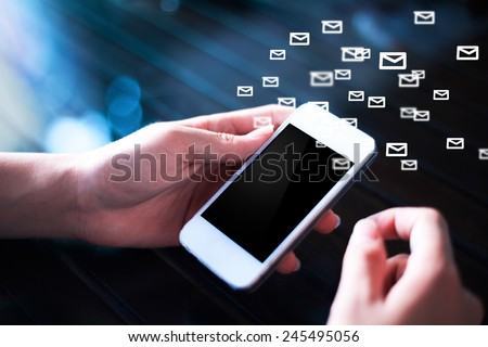Man hand holding a phone sending email,social media concept  - stock photo