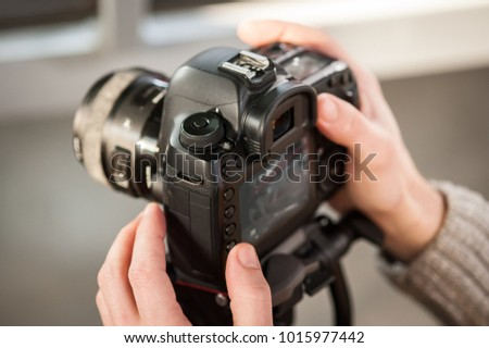 Man hand holding camera and take the photo. Selective focus