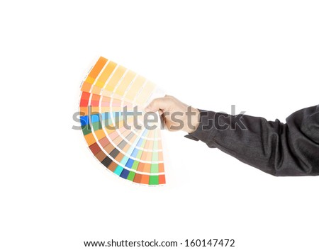 Man hand holding color samples. Isolated on a white background.