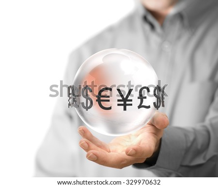 Man hand holding glass sphere with currencies around it. Concept image for illustration of currency exchange. - stock photo