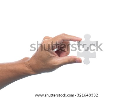 Man hand holding jigsaw puzzle on white background