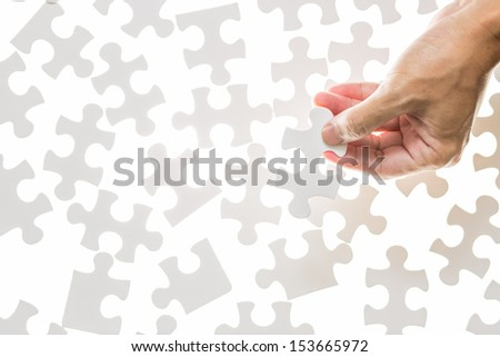 Man hand holding jigsaw puzzle piece,Success concept