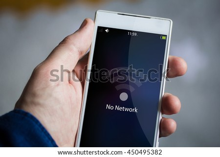 man hand holding no network smartphone. All screen graphics are made up.