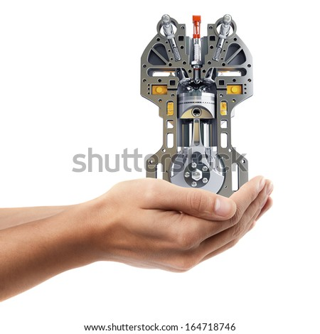 Man hand holding object ( Car engine )  isolated on white background. High resolution  - stock photo