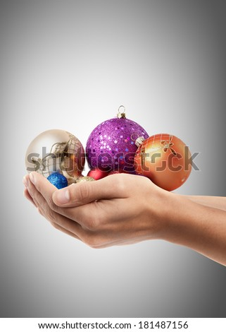 Man hand holding object ( christmas balls )  High resolution