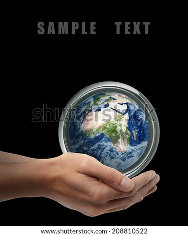 Man hand holding object ( Earth ) isolated on black background. High resolution. including elements furnished by NASA  - stock photo