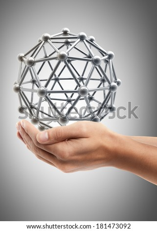 Man hand holding object ( silver glossy molecules structure )  High resolution  - stock photo