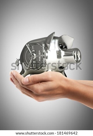 Man hand holding object ( steel Piggy bank with vault door )  High resolution  - stock photo