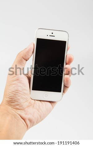 Man hand holding smart phone like iphones in vertical position, isolated on white background - stock photo
