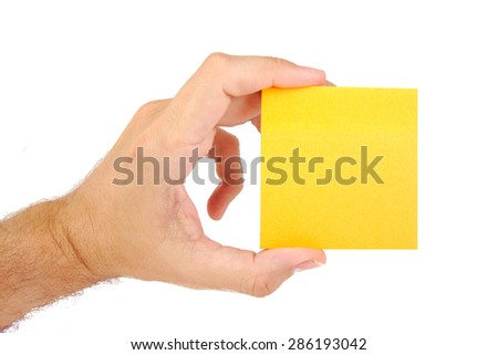 Man hand holding sticky note isolated on white background - stock photo