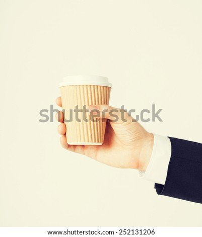 man hand holding take away coffee cup - stock photo