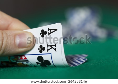 Man Hand Holds Ace with King and Poker Chips - stock photo