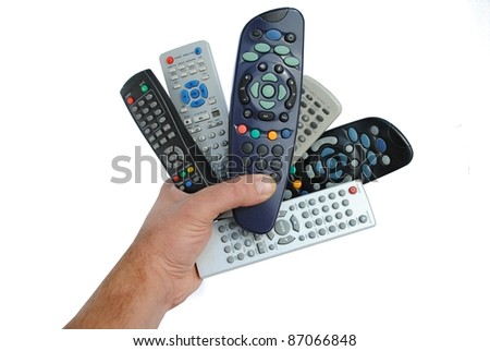man hand holds six remote control, isolated on white background