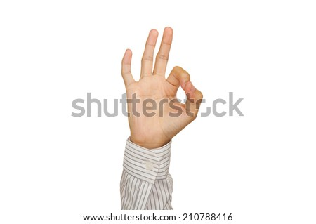Man hand in OK sign on a white isolated background. - stock photo
