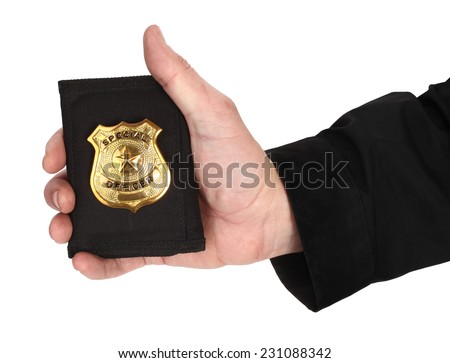 Man hand is holding golden special officer badge - stock photo
