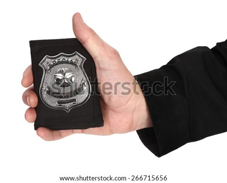 Man hand is holding special police badge - stock photo