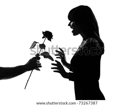 man hand offering a flower rose stylish sexy silhouette caucasian beautiful woman on studio isolated white background - stock photo