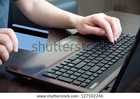 Man hand on keyboard with credit card