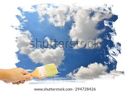 Man hand paint white clouds and blue sky - stock photo