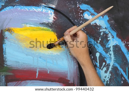 man hand painting blue abstract picture - stock photo