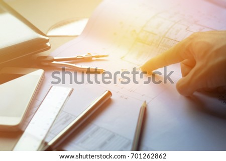 Blueprint pen ruler stock images royalty free images vectors man hand pointing blueprintdivider pencil pen ruler glasses and smartphone malvernweather Image collections