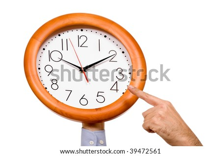 man hand pointing to a clock isolated in white background - stock photo