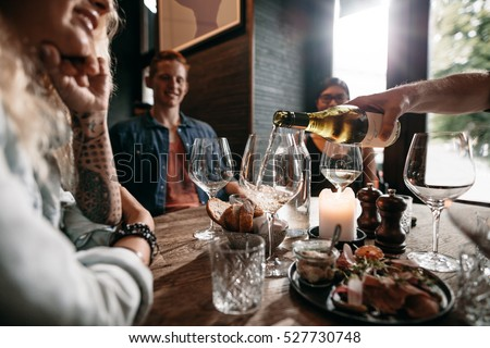 Man Hand Pouring White Wine Bottle Stock Photo 527730748 ...