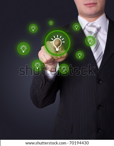 Man hand pressing light bulp icon - stock photo