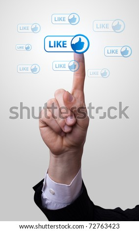 man hand pressing like button - stock photo