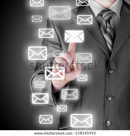 Man hand pressing mail symbol.