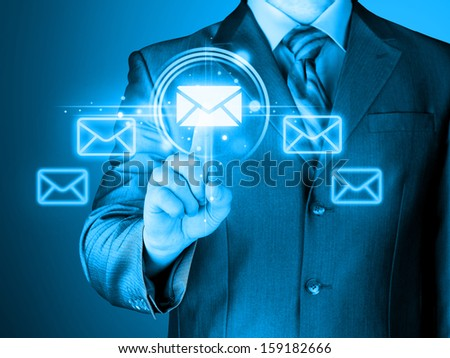 Man hand pressing mail symbol. - stock photo