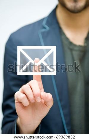 Man hand pressing mail symbol. - stock photo