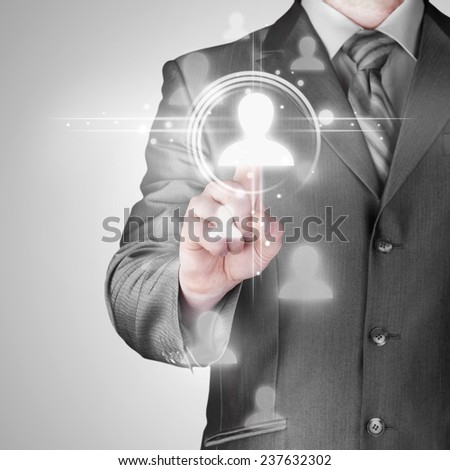 man hand pressing social media icon - stock photo