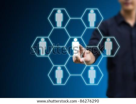 man hand pressing Social network icon - stock photo