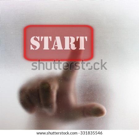 Man hand pressing START button - stock photo