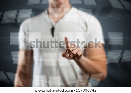 Man hand pushing digital button on touch screen interface - stock photo