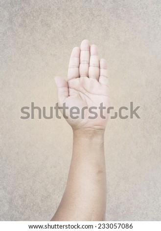 Man hand raised up.  International Volunteers Day concept. - stock photo