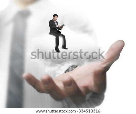 Man hand showing businessman using smart tablet sitting on white cloud. - stock photo