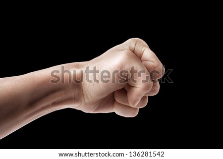 Man hand sign blow isolated on black background - stock photo