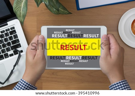 man hand Tablet with RESULT Concept screen and coffee cup - stock photo