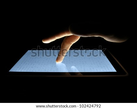 Man hand touching screen on modern digital tablet pc. - stock photo