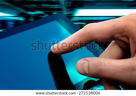 Man hand touching screen on modern digital tablet pc. Close-up image with shallow depth of field focus on finger. - stock photo