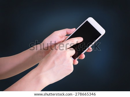 Man hand touching screen on modern mobile smart phone. Close-up image with shallow depth of field focus on finger. - stock photo