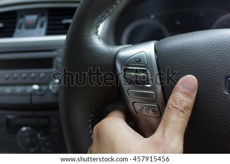 man hand use the switch. Car interior detail