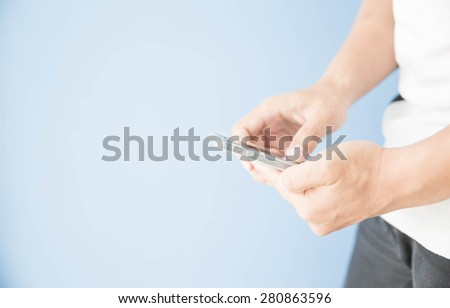Man hand using smart phone - stock photo